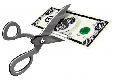 Scissors Cutting Dollar Bill